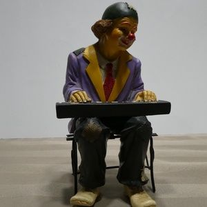 Other - CLOWN porcelain figurine playing the keyboard